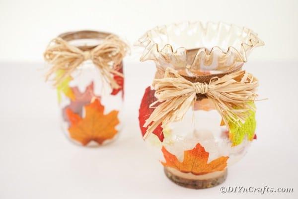Fall leaf jars on white table