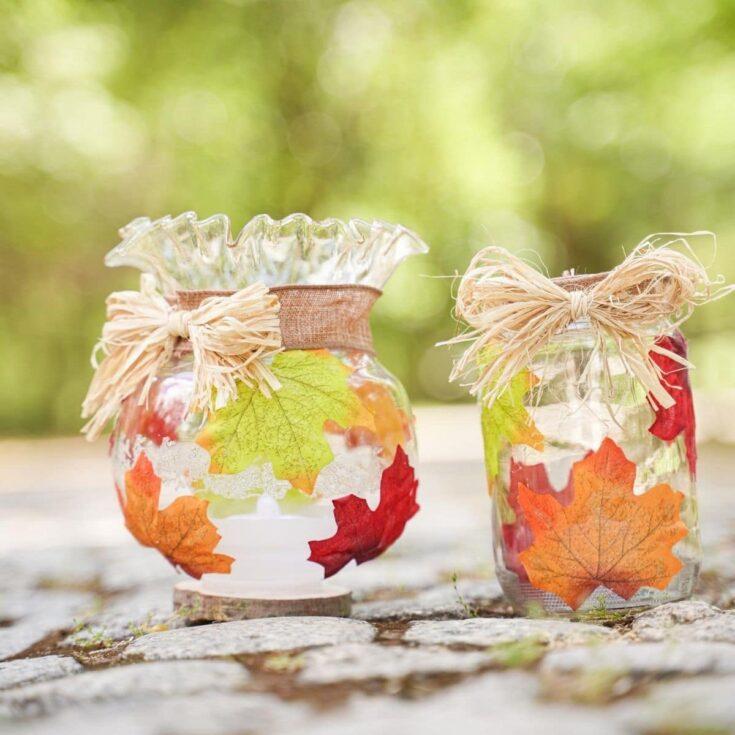 Two fall leaf jars on rocks