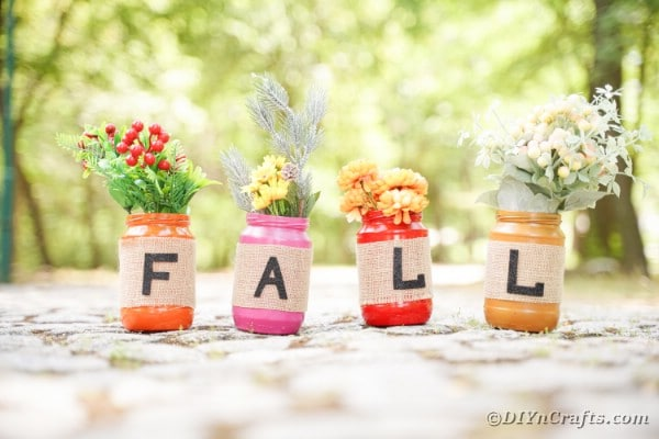 Fall mason jar decor on cobblestone