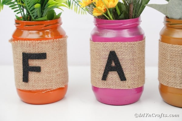 Fall mason jar decor on white table