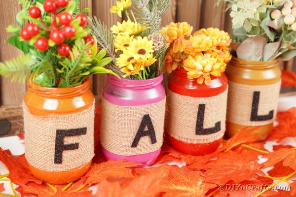 Fall mason jars on fake leaves