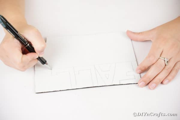 Drawing a word on foam paper