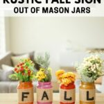 Lettered fall mason jar decor on a table