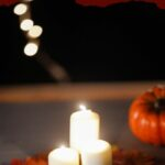 Candles lit on leaf fall placemat
