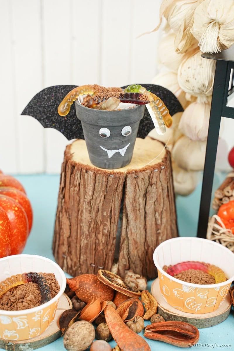Bat flower pot on stump
