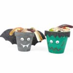 Flower pot Halloween characters on white table