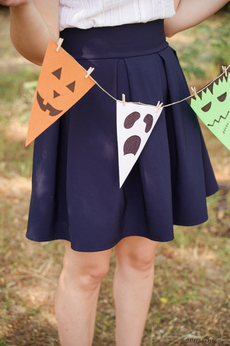 Woman holding Halloween garland