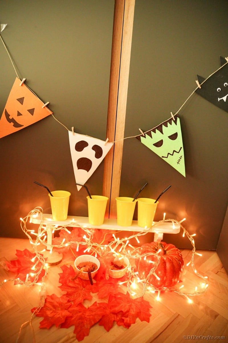 Halloween bunting hanging by orange cups