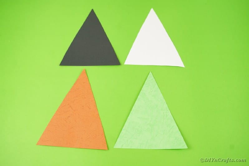 Colorful triangle bunting on green table