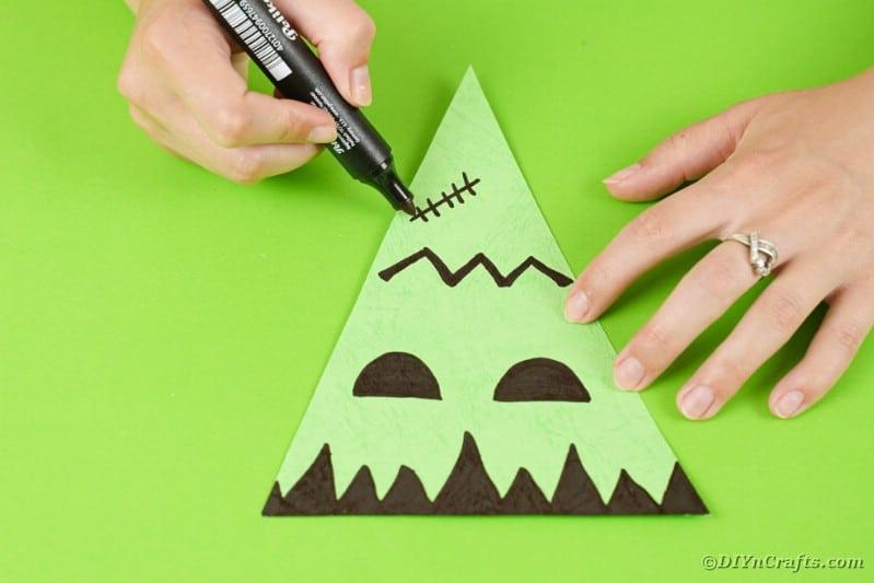 Frankenstein face on green paper
