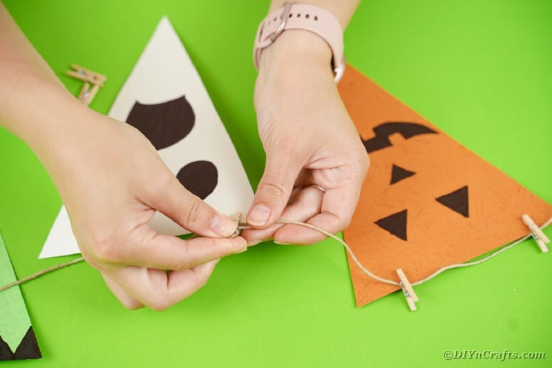 Attaching Halloween character flags to twine