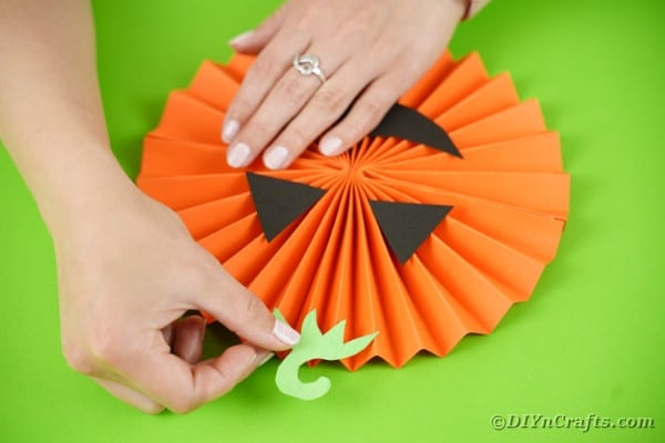 Gluing stem onto paper pumpkin
