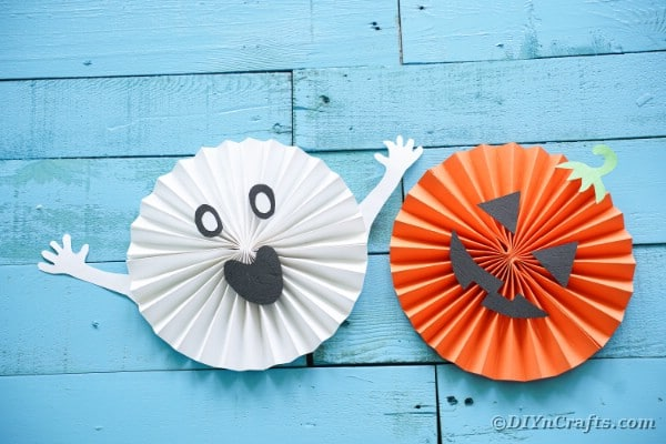 Halloween paper fans on blue boards