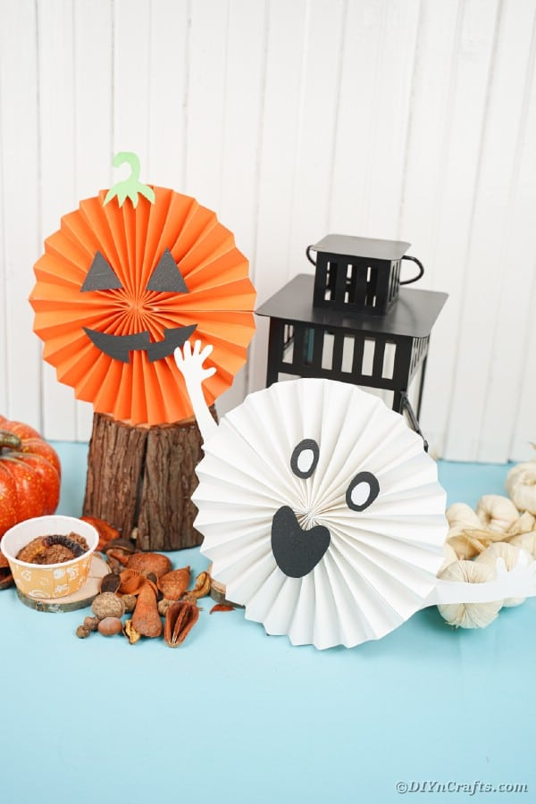 Halloween paper fans by black lantern