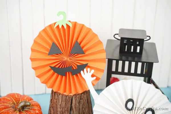 Pumpkin paper fan by black lantern