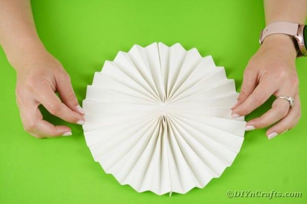 Round folded paper fan