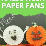 Halloween paper fan decorations by chalkboard