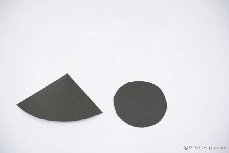 Black paper circle and triangle