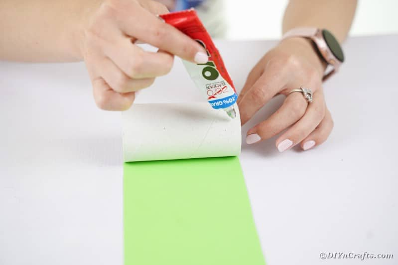 Gluing paper onto roll