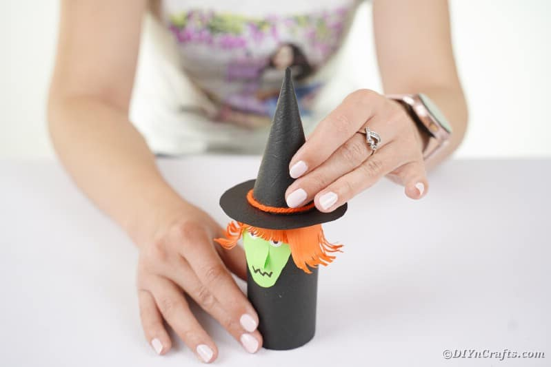Adding a hat to a paper roll witch