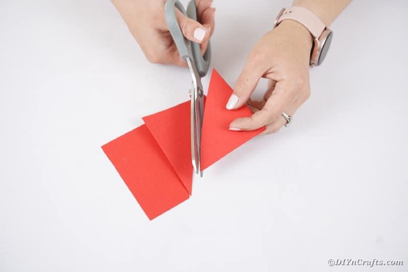 Cutting red paper