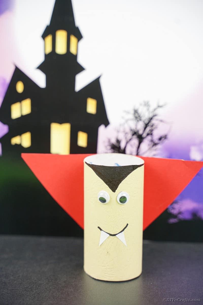 Toilet paper vampire by Halloween background