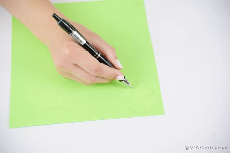 Drawing face on green paper