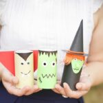 Woman holding toilet paper roll Halloween characters