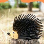 Black straw hedgehog on stump