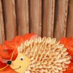 Pistachio hedgehog on fall leaves