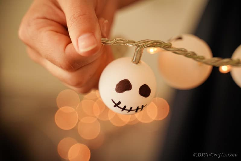 Woman holding Jack Skellington garland