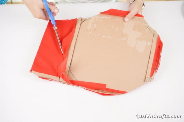 Cutting cardboard into a circle