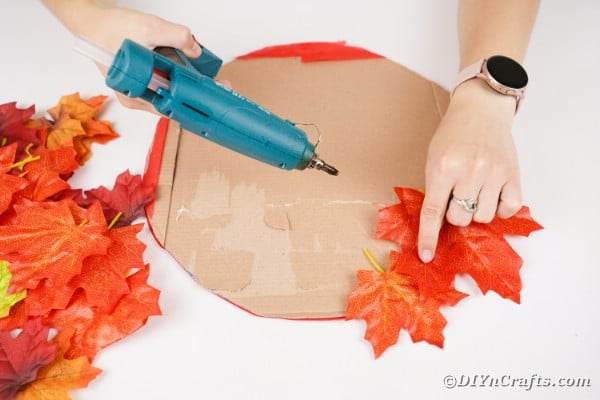 Gluing leaves onto cardboard