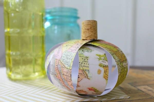 Paper map pumpkin on table