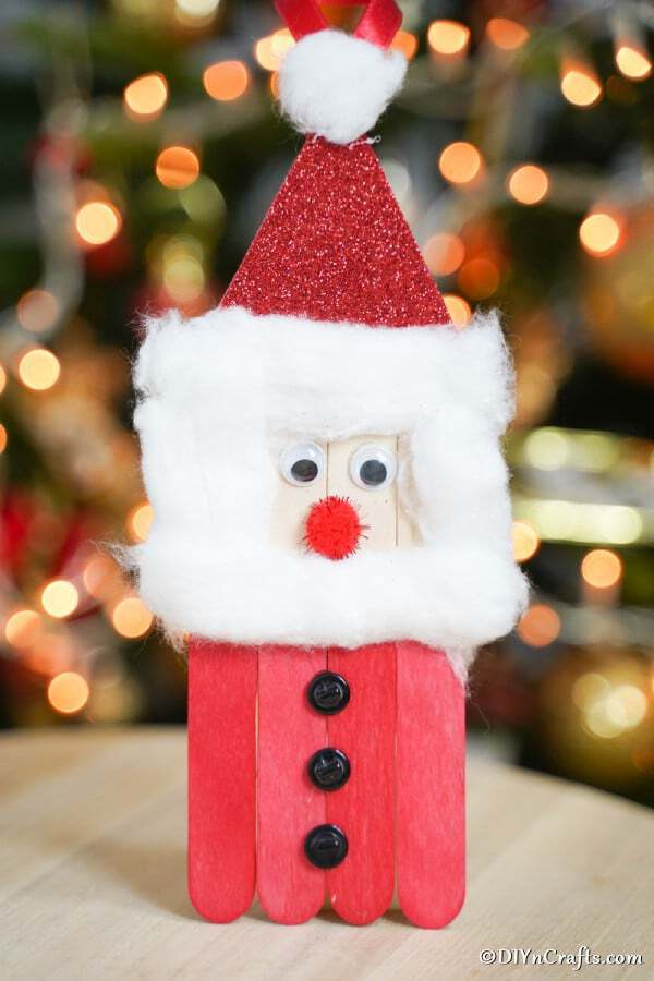 Craft stick santa on table