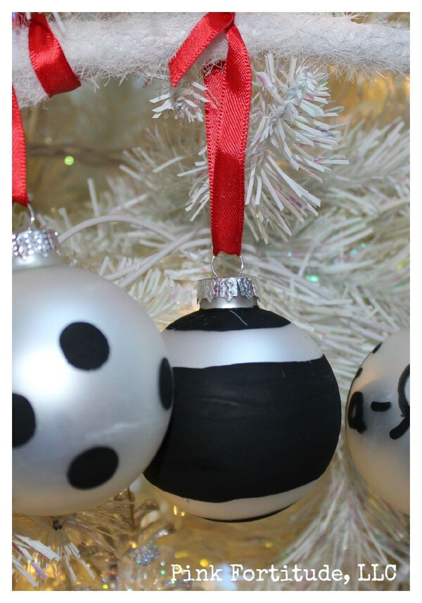 Black and silver ornament in white tree