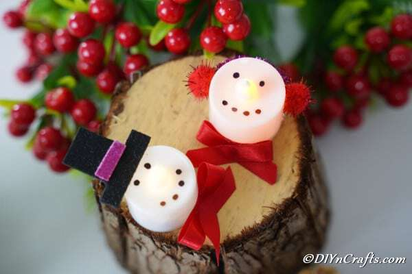 Candle ornaments on stump