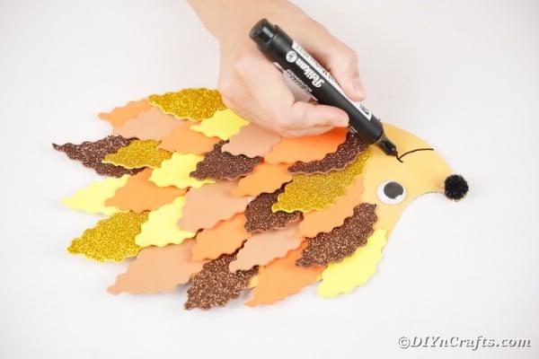 Drawing smile onto hedgehog