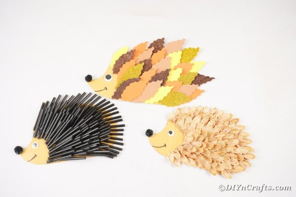 Hedgehogs on white table