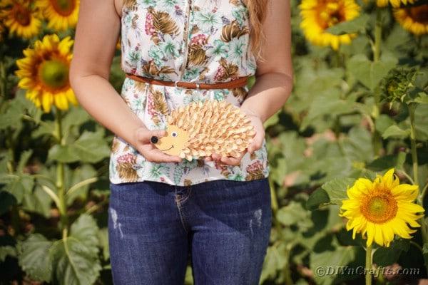 Woman holding pistachio hedgehog