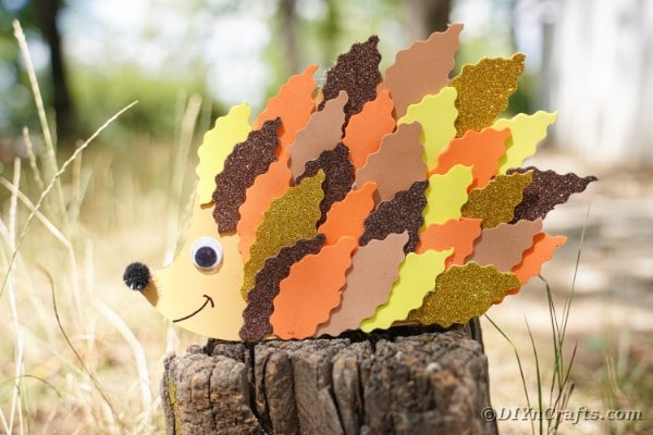 Paper leaf hedgehog on stump