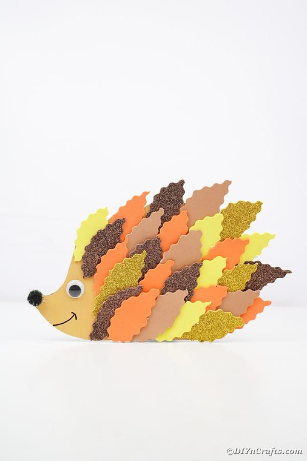 Paper leaf hedgehog on white table