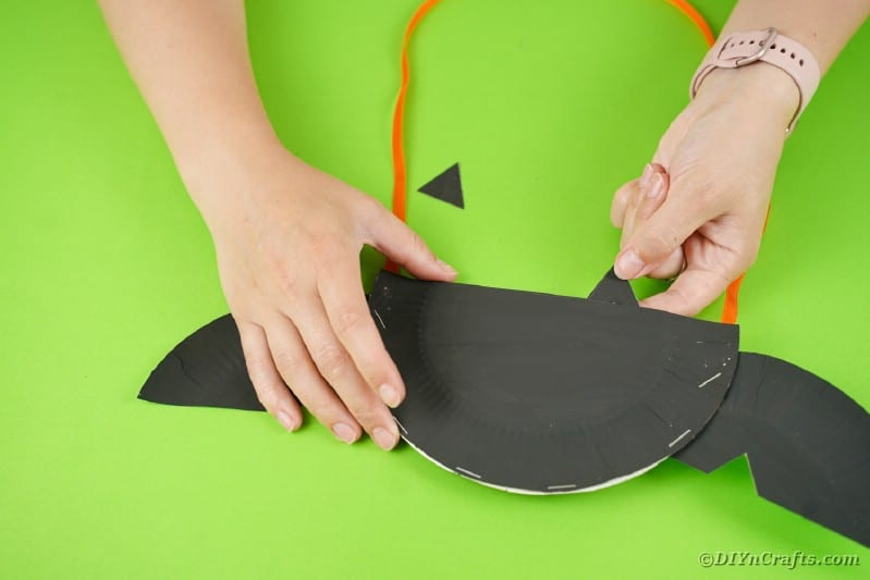 Attaching wings to paper plate bat