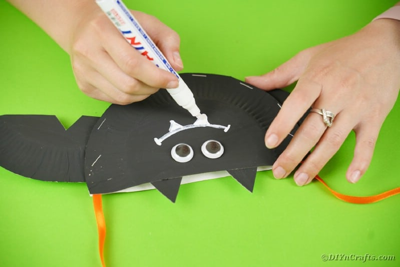 Drawing a smile on the bat face