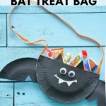 Bat filled with candy on blue boards