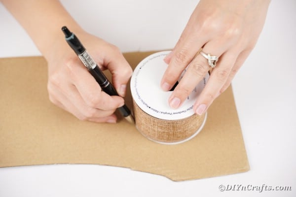 Tracing a circle onto cardboard