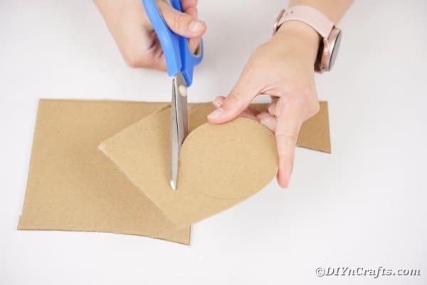 Cutting a circle from cardboard