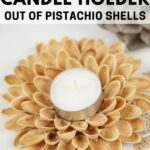 Pistachio shell candle holder on white table