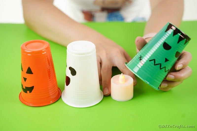 Adding candle under lantern