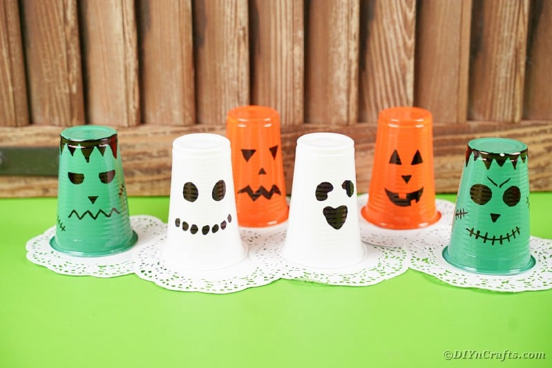 Plastic cup lanterns on green table